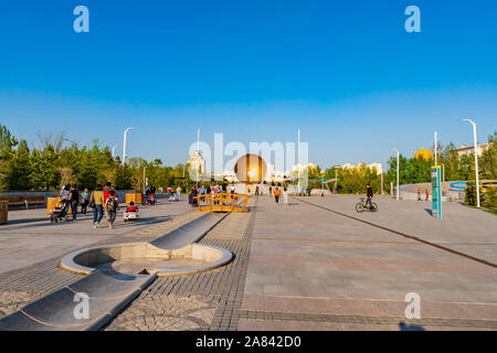 Nur-Sultan Astana Central City Tsentralnyy Gorodskoy Park View of a Bowl Shaped Sculpture on a Sunny Blue Sky Day - Stock Photo