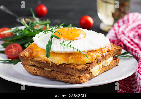 Breakfast. French cuisine. Croque madame sandwich close up on the table. - Stock Photo