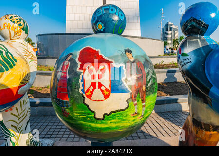 Nur-Sultan Astana Central City Tsentralnyy Gorodskoy Park View of Sculpture Holding Serbia Ball on a Sunny Blue Sky Day - Stock Photo