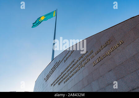Nur-Sultan Astana Central City Tsentralnyy Gorodskoy Park View of Waving Kazakhstan Flag on a Sunny Blue Sky Day - Stock Photo