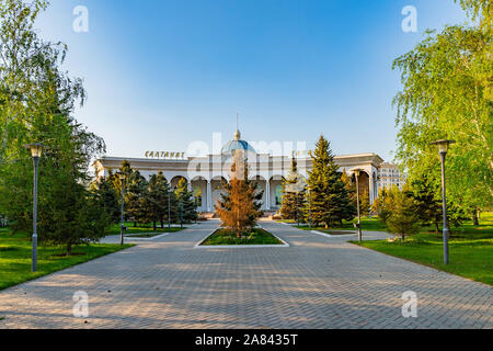Nur-Sultan Astana Central City Tsentralnyy Gorodskoy Park View of Saltanat Sarayy Building on a Sunny Blue Sky Day - Stock Photo