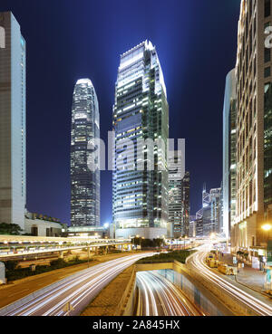 Modern office buildings in Central Hong Kong at night with traffic