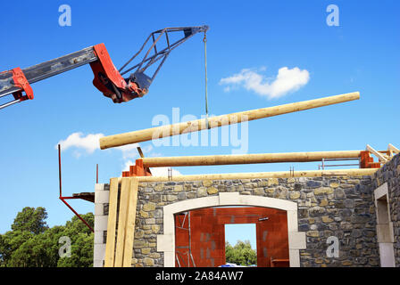 Installation of roof beams using a telescopic crane. - Stock Photo