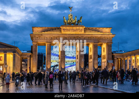 People collect at Brandenburger Tor to celebrate 30th Anniversary of the fall of the Berlin Wall, Pariser Platz, Mitte, Berlin, Germany - Stock Photo