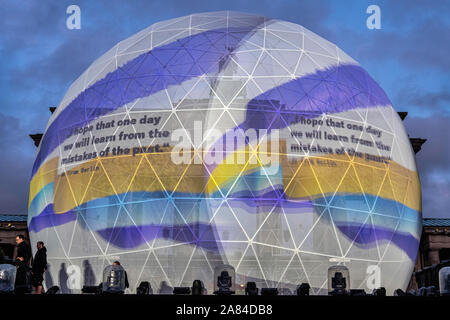 Celebrating 30th Anniversary of the Fall of the Berlin Wall. Concert stage and Huge white globe that is illuminated with messages of peace after dark at the Brandenburg gate, Straße des 17. Juni, Berlin - Stock Photo