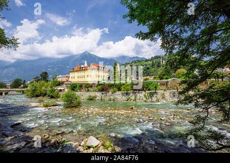 MERANO, ITALY - JULY 20, 2019 - Merano Winterpromenade along the torrente Passirio. Its most distinctive landmark is the Wandelhalle covered passagewa - Stock Photo