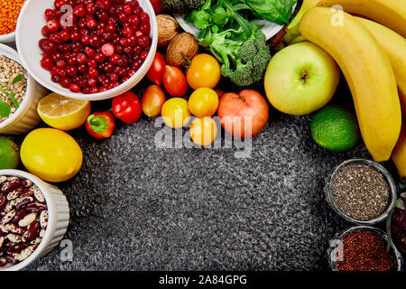 Healthy food background, trendy Alkaline diet products - fruits, vegetables, cereals, nuts, oils, dark grey concrete background. Free for trext. Top v - Stock Photo