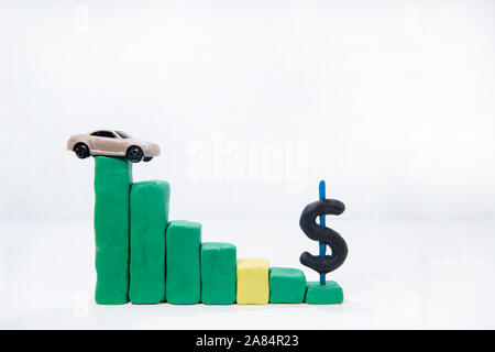 Abstract composition of car prices in auto-market. Isolated on white background. - Stock Photo