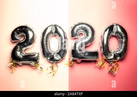 Balloon Bunting for celebration of New Year 2020 made from Silver Number Balloons. Holiday Party Decoration or postcard concept with top view and copy space. - Stock Photo