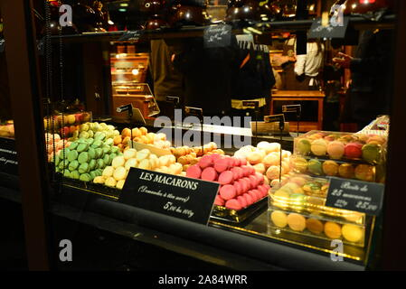 Colourful macarons on display in the window in Paris