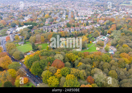 Top down aerial photo in autumn showing the beautiful fall autumn colours of a park and pond opposite a golf course in Leeds known as The Roundhay Par - Stock Photo