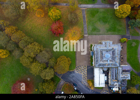 Aerial photo in autumn showing the beautiful autumn colours of a park in Leeds known as Roundhay Park in West Yorkshire UK showing The Mansion Hotel a - Stock Photo