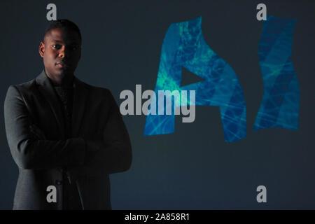 Double exposure portrait confident businessman and AI text - Stock Photo