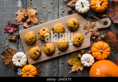 Overhead view of pumpkin chocolate chip cookies on wooden table. - Stock Photo