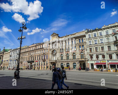 Saint Petersburg/Russia; May 14 2017: Nevsky Prospect main street, with blue sky and people walking, Saint Petersburg, Russia - Stock Photo