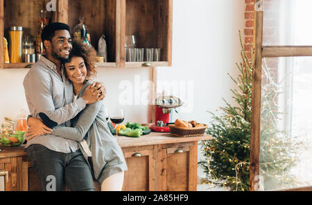 Young loving couple having good time at christmas morning - Stock Photo
