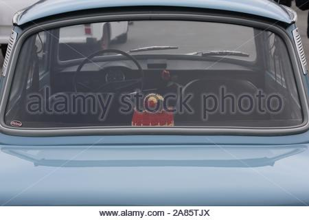 An original blue Trabant car bearing the German colours inside and parked in the town of Hof for the 25th anniversary of the fall of the Berlin Wall. - Stock Photo