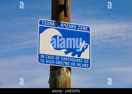 """Tsunami Hazard Zone"" warning sign, Monterey, California, United States of America. - Stock Photo"