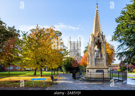St Mary de Lode church and Bishop Hoopers Monument in autumn in St Marys Square, Gloucester UK - Stock Photo