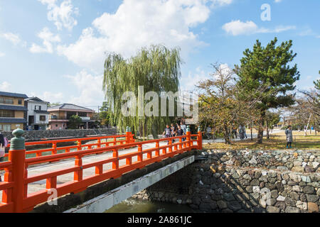 Uji, Kyoto Prefecture, Japan - October 27th, 2019: People sightseeing in Uji, a city on the southern outskirts of the city, on a sunny autumnd day. - Stock Photo