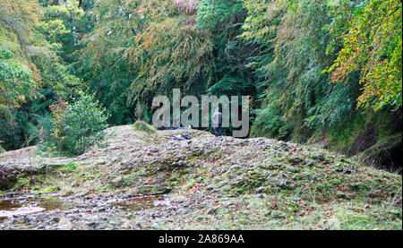 An angler salmon fishing on the Upper Beat of the River North Esk near Edzell, Angus, Scotland, United Kingdom, Europe. - Stock Photo
