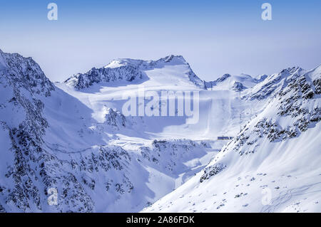 Ski lifts, runs and pistes on Rettenbach Glacier in Solden ski resort in Otztal Alps in Tirol, Austria. The place of the first World Cup giant slalom - Stock Photo