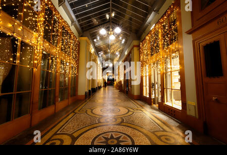 Galerie Vivienne is an ancient historical shopping passage with shops, cafes, and restaurants. It's one of the tourist attractions in Paris in France - Stock Photo