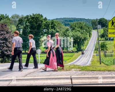 Lancaster, Pennsylvania, June 2019 - Amish Teenagers Walking Along Train Tracks in Countryside on a Sunny Day - Stock Photo