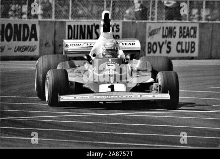 Niki Lauda in his Ferrari 312T2 at the Long Beach Grand Prix - The United States Grand Prix of 1977.   Andreas Nikolaus Lauda was an Austrian Formula One driver, a three-time F1 World Drivers' Champion, winning in 1975, 1977 and 1984, and an aviation entrepreneur. He is the only driver in F1 history to have been champion for both Ferrari and McLaren, the sport's two most successful constructors. 22 February 1949 – 20 May 2019) was an Austrian Formula One driver, a three-time F1 World Drivers' Champion, winning in 1975, 1977 and 1984, and an aviation entrepreneur. He is the only driver in F1 hi - Stock Photo
