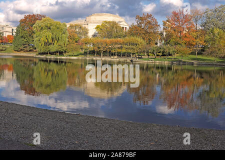 Wade Lagoon in in the University Circle district of Cleveland, Ohio, USA reflects the autumn foliage from the trees surrounding this urban oasis. - Stock Photo
