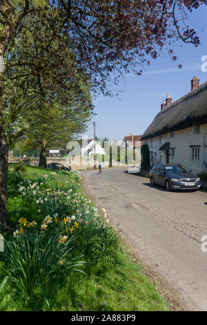 A springtime view of the main street in the pretty village of Newton Blossomville, Buckinghamshire, UK - Stock Photo