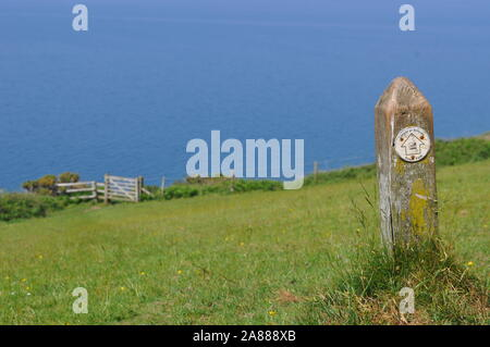 A Way marker pointing the way on the Ceredigion Coastal Path, part of the all Wales Coast Path - Stock Photo