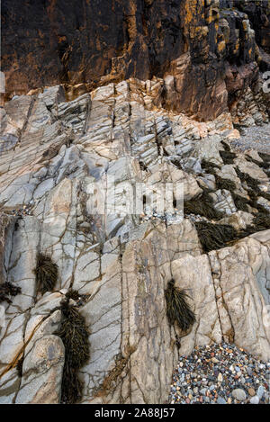 Natural abstract of rocks on Criccieth beach in North Wales. - Stock Photo