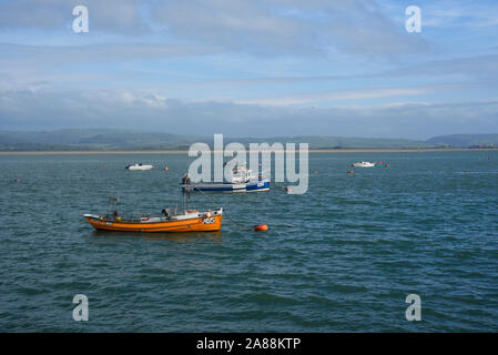 Small fishing boats in the Dyfi estuary, Cardigan Bay, from Aberdovey (Aberdyfi), Gwynedd, West Wales, UK - Stock Photo