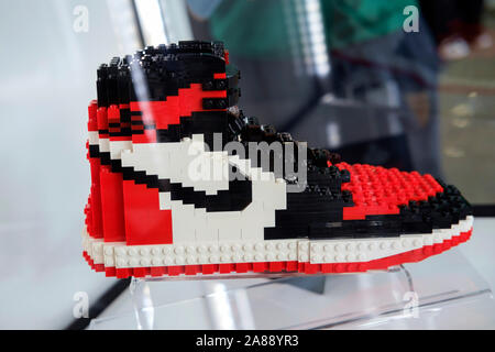 Nike iconic shoe made with Lego plastic pieces exhibited at Sneakerness fair in Milano, 2019. - Stock Photo