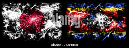 Japan, Japanese vs Swaziland, Swazi New Year celebration sparkling fireworks flags concept background. Combination of two abstract states flags. - Stock Photo