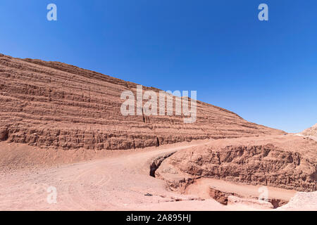 Road in the red sandy mountains of Timna Park. Eilat. Israel - Stock Photo