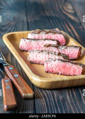 Slices of strip steak close-up - Stock Photo