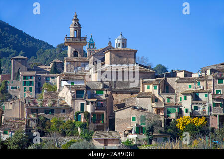 The mountain village Valldemossa, church Saint Bartomeu, behind the Carthusian monastery, region Comarca, Serra de Tramuntana, Mallorca, Spain - Stock Photo