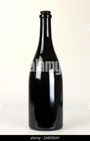 Black glass bottle for champagne wine isolated on white background - Stock Photo