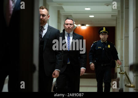 Lieutenant Colonel Alexander Vindman, a military officer at the National Security Council, center, arrives at the U.S. Capitol on Thursday, November 7, 2019 to review transcripts from his closed-door testimony before House committees on Tuesday, October 29, 2019 on Capitol Hill in Washington D.C., U.S.  Credit: Stefani Reynolds / CNP /MediaPunch - Stock Photo