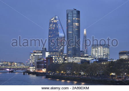 One Blackfriars, South bank Tower and The Shard - modern glass skyscrapers illuminated at dusk, London UK - Stock Photo