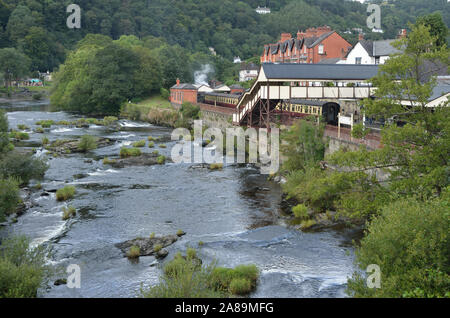 River Dee; Llangollen; Denbighshire; Wales; UK;United Kingdom; Europe.  rushing stream; LLangollen Railway Station. - Stock Photo