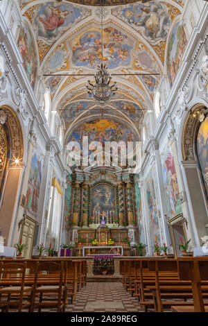 ACIREALE, ITALY - APRIL 11, 2018: The nave of baroque church Chiesa di San Camillo with the frescoes by Pietro Paolo Vasta (1745 - 1750). - Stock Photo