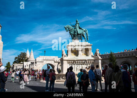 St Matthias church was where the Hungarian Kings held their coronations was renovated in 2012 The bronze statue of Stephan I of Hungary stands outside - Stock Photo