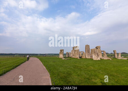 Tourists in Stonehenge,  a ring of standing stones, prehistoric monument, Wiltshire, England, UK - Stock Photo