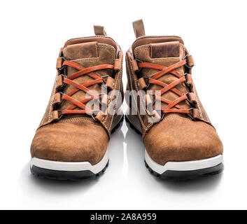 Pair of brown sneakers isolated on white background - Stock Photo
