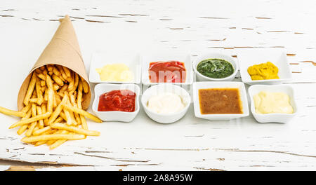 French fries with different sauces - Stock Photo