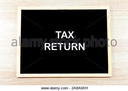 Chalkboard with the words 'Tax Return' - Stock Photo