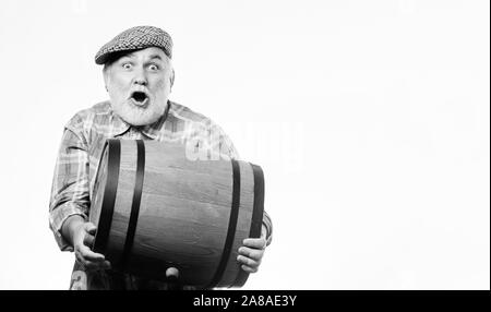 Winery concept. Homemade wine. Man bearded senior carry wooden barrel for wine white background. Producing wine family tradition. Fermentation product. Natural wine made out of organic grapes. - Stock Photo